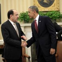 Weapons push: U.S. President Barack Obama shakes hands with Iraqi Prime Minister Nouri al-Maliki on Friday, following their meeting in the Oval Office of the White House in Washington | AP