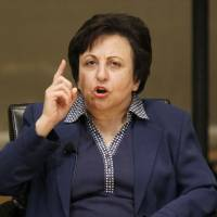 Reformer in name only?: Iran's Shirin Ebadi participates in the World Summit of Nobel Peace Laureates in Chicago in April 2012. In an interview Tuesday, Ebadi, a U.S.-based human rights lawyer who has lived outside Iran in self-exile since 2009, strongly criticized the human rights record of Iranian President Hassan Rouhani, citing a dramatic increase in executions since he took office this year and accusing his government of lying about the release of political prisoners   AP