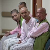 Former South Korean leprosy patients return to infamous island colony