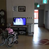 Lonely life: A former South Korean leprosy patient watches a television at Sorokdo National Hospital on Sorok Island, South Korea, on Nov. 4. The island, once known as a place where hospital workers beat the leprosy patients exiled there and forced them into harsh labor, sterilizations and abortions, has become a peaceful refuge for many after years of discrimination and hardship and the only place they feel at home. | AP