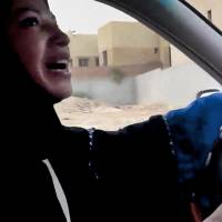 Taking the wheel: A Saudi Arabian woman takes part in a campaign to defy the kingdom's ban on female drivers in Riyadh in June 2011 | AP