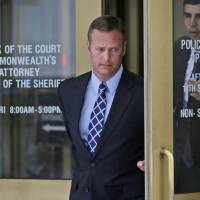 Leading by example?: U.S. Air Force Lt. Col. Jeffrey Krusinski, who led the service's Sexual Assault Prevention and Response unit, leaves the General District Court in Arlington, Virginia, on July 18 after being criminally accused of groping a woman. On Wednesday, a seven-member jury found Krusinski not guilty. | AP