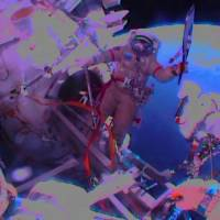 Spaced out: Cosmonaut Oleg Kotov holds the Sochi 2014 Winter Olympic Games Torch during a spacewalk outside the International Space Station on Saturday. The torch also visited the ISS ahead of the 1996 Summer Games in Atlanta and the 2000 Olympic Games in Sydney, but this is the first time it has been along for a spacewalk   AFP-JIJI