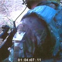 Murderous intent: Footage from a helmet-mounted camera shows a Royal Marine on patrol in Afghanistan.  A Royal Marine, known only as Marine A, was convicted Friday by a court martial board of murdering a wounded Afghan insurgent in September 2011 based partly on evidence inadvertently recorded by another soldier | AP