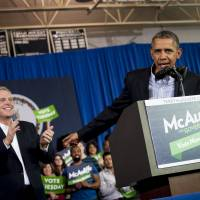 Presidential push: President Barack Obama delivers remarks at a campaign event for Virginia Democratic gubernatorial candidate Terry McAuliffe  in Arlington on Sunday | BLOOMBERG