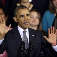 Slow going: U.S. President Barack Obama speaks Oct. 30 at Boston's historic Faneuil Hall about the federal health care law. Sources say only 40,000 people have signed up   AP