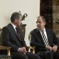 New allies?: Russian Foreign Minister Sergey Lavrov (right) talks with Russian Defense Minister Sergei Shoigu before meeting with Egypt's interim president on Thursday at the presidential palace in Cairo. | AFP-JIJI