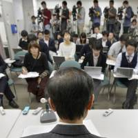 Winner: A 66-year-old plaintiff faces reporters during a news conference after the Osaka District Court ruled Monday that it is unconstitutional to set any age difference between widows and widowers for pension entitlement. | KYODO