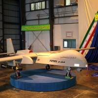 Real deal?: An Iranian missile-equipped drone dubbed 'Fotros' is unveiled at a ceremony in Tehran on Monday. Iranian Defense Minister Mohammad Dehgan said the drone has an operational range of 2,000 km and can fly at an altitude of 25,000 feet with a flight time autonomy of 16 to 30 hours. | AFP-JIJI