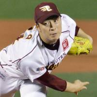 Outstanding start: Eagles hurler Manabu Mima holds the Giants to zero runs and one hit over six innings in Game 7 on Sunday   KYODO