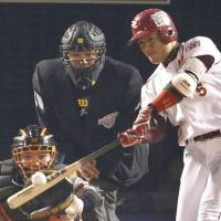 Big blast: The Eagles' Akihisa Makida slugs a home run in the fourth inning against the Giants in Game 7 of the Japan Series on Sunday. Tohoku Rakuten defeated Yomiuri 3-0 to capture its first championship | KYODO