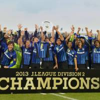 Can't keep us down: Gamba Osaka celebrate after winning the J. League second-division title on Sunday after beating Montedio Yamagata 3-2 | KYODO