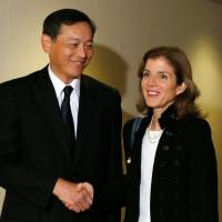 First contact: New U.S. Ambassador to Japan Caroline Kennedy (right) meets with Akitaka Saiki, vice minister for foreign affairs, at the Foreign Ministry in Tokyo on Monday. | POOL