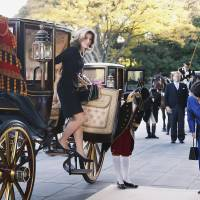 Royal stage: New U.S. Ambassador to Japan Caroline Kennedy steps out of a horse-drawn Imperial carriage upon her arrival at the Imperial Palace in Tokyo on Tuesday before presenting her credentials to Emperor Akihito. | AP