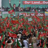 No-drone zone: Supporters of the Tehreek-e-Insaf party headed by Pakistan cricketer-turned-politician Imran Khan, wave their party's flag and chant slogans during a protest against U.S. drone strikes in Pakistan, in Peshawar on Saturday. | AP