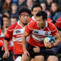Best foot forward: Kenki Fukuoka of Japan's Brave Blossoms dashes forward while receiving a tackle during Saturday's 42-17 defeat to Scotland at Murrayfield Stadium in Edinburgh. | KYODO