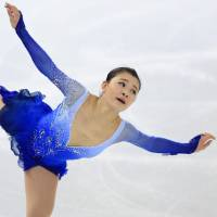 Artistic elegance: Kanako Murakami skates during the free program on Saturday at the Cup of Russia in Mosow. | KYODO