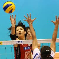 Pinpoint control: Japan's Saori Sakoda taps the ball over the net against Thailand during the teams' FIVB Women's Grand Champions Cup match on Friday at Tokyo Metropolitan Gymnasium. Japan defeated Thailand 25-20, 29-27, 25-22 | FIVB