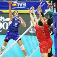 Here it comes: Russia's Dmitriy Ilinykh attacks Japan's double block during Wednesday's FIVB Men's Grand Champions Cup match in Kyoto. Russia defeated Japan 25-16-, 25-17, 25-18. | FIVB
