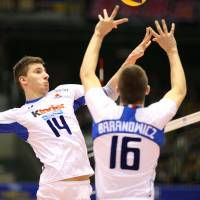 Like clockwork: Italy's Michele Baranowicz sets the ball for teammate Matteo Piano during Saturday's FIVB Men's Grand Champions Cup match against Japan at Tokyo Metropolitan Gymnasium. Italy defeated Japan in three straight sets. | FIVB