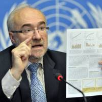Emissions spike: World Meteorological Organization Secretary-General Michel Jarraud presents the entity's annual greenhouse gas report at a news conference at U.N. headquarters in Geneva on Wednesday. The agency said concentrations of carbon dioxide in the atmosphere have accelerated and reached a record high in 2012 | AP