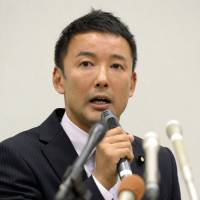 Hot seat: Upper House lawmaker Taro Yamamoto faces the media Tuesday in Tokyo to answer questions on why he broke with protocol and gave a letter to Emperor Akihito last week | KYODO