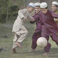 Ball boys: Afghan boys play soccer at their school in Kandahar, southern Afghanistan. Recent studies suggest that fitness is the cause of higher test scores for kids. | AP