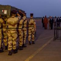 Going home: French soldiers carry the casket of one of the two journalists executed in northern Mali, during a military ceremony for the removal of the bodies at Bamako military airport in Mali. | AP