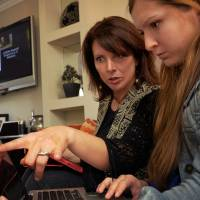 Think empowerment: Kathy Korman Frey (left) and Hannah Friedman talk at a gathering to watch the Hot Mammas Project awards Saturday in Washington. | THE WASHINGTON POST