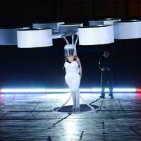 Lofty quest: Lady Gaga demonstrates the prototype Volantis flying dress during the 'Artpop' album release and 'artRave' event at the Brooklyn Navy Yard on Sunday in New York City. Inset: Lady Gaga speaks at the event. | AP