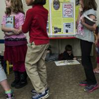 At risk?: Girls wait at an American Girl series book-signing event at Arlington Library in Arlington, Virginia, in April. | AFP-JIJI