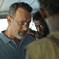Unwelcome passengers: Tom Hanks plays Capt. Richard Phillips in Paul Greengrass' 'Captain Phillips.' The film is based on the true story of a cargo ship hijacked by Somali pirates.