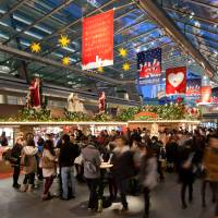 Decked out for Christmas: Shoppers browse through the German Christmas Market at Tokyo's Roppongi Hill complex.