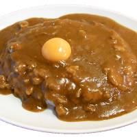 Raw beauty: The curry at Hinoya, voted the best in the curry-packed Kanda area of Tokyo, comes topped with a choice of raw or soft-boiled egg. The tiny restaurant close to Kanda Station seats just seven hungry customers. | STEVE TRAUTLEIN