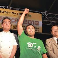 Curry king: The owner of Hinoya wins first prize at the Kanda Curry Grand Prix earlier this month. | STEVE TRAUTLEIN