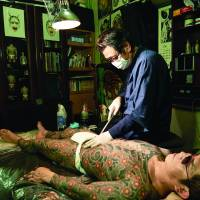 Pain and ink: Horimitsu in his studio at work on a full-body tattoo. | IRWIN WONG
