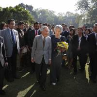Imperial alliance: Emperor Akihito and Empress Michiko visit Lodi Gardens, home to the tombs of 15th- and 16th-century Mughal emperors, in New Delhi on Dec. 1. | AP