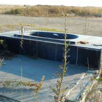 Exposed: A bathtub and concrete foundation are all that remain of a house on the unprotected coast in Sendai City, Miyagi Prefecture, after the March 11, 2011, tsunami.   STEPHEN HESSE PHOTO