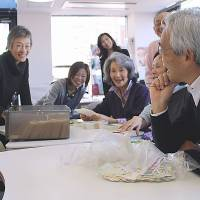 Wishing well: Make-a-Wish of Japan staffers enjoy making dreams come true for children with life-theatening illnesses. The organization is aiming to fulfill 200 wishes this year.   JUN HONGO