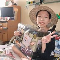 The gift of hope: A young girl poses for a photo after her wish was granted by Make-a-Wish of Japan.   COURTESY OF MAKE-A-WISH JAPAN