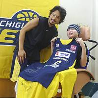 From top: Basketball star Yuta Tabuse grants a fan's wish at a practice sessions; a boy poses for a photo with a conductor after taking a tour of the Doctor Yellow high-speed test train; a 'One Piece' fan is all smiles after receiving toys and a trademark hat.   COURTESY OF MAKE-A-WISH OF JAPAN