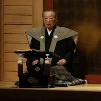 Holding forth: Takemoto Sumitayu VII at work during a bunraku performance in his role as the narrator and voice actor. | COURTESY OF THE NATIONAL BUNRAKU THEATRE