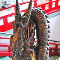 Stare furniture: An ornamental dragon gets its mouth around a jewel on a balustrade in the Fujiya Hotel. | CHRIS BAMFORTH PHOTO