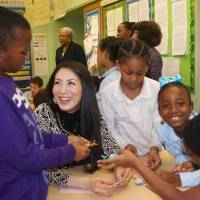 Outreach: Ikumi Yoshimatsu, Miss International 2012, shows third-graders at Public School 307 in Brooklyn, New York, how to fold origami frogs Jan. 24. | KYODO