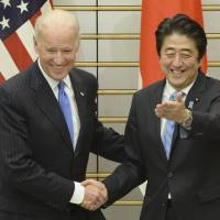 In the zone: U.S. Vice President Joe Biden is welcomed by Prime Minister Shinzo Abe at the prime minister's office Tuesday. | AP/POOL