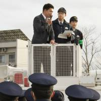 Humor me: A 'DJ Cop' from the Tokyo Metropolitan Police Department holds a demonstration for trainees at the Tottori Prefectural Police Academy on Dec. 5. | KYODO