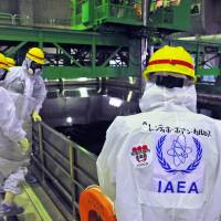 In deep water: Experts from the International Atomic Energy Agency, the U.N. nuclear watchdog, conduct an inspection of the Fukushima No. 1 plant on Nov. 27. | AFP-JIJI