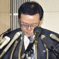 Bad times and good: Tokyo Gov. Naoki Inose announces his resignation at the metropolitan government building Thursday.  | YOSHIAKI MIURA