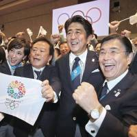 Inose (second from left) celebrates with Prime Minister Shinzo Abe (center) in Buenos Aires in September as Tokyo was picked to host the 2020 Olympics. | GETTY IMAGE/KYODO