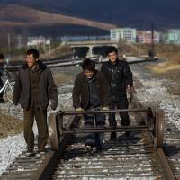 Off the rails?: Workers Thursday push a handcart down tracks running parallel to a new line linking the city of Rajin, in the Rason Special Economic Zone, to the Russian border. | AP